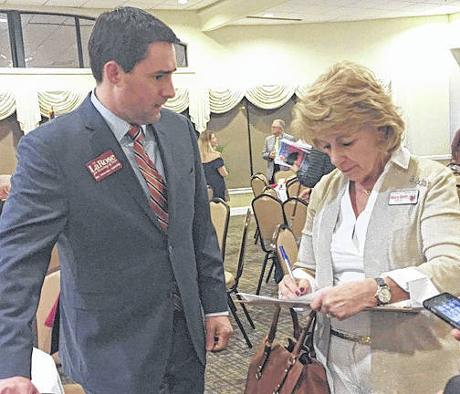 Submitted photo Mary Beth Kemmer speaks with Frank LaRose.