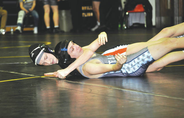 Beavercreek's Kaileigh Nuessgen (left) pins Fairborn's Chris Martin in a 106-pound sectional tournament match in Centerville, and eventually won the division's title. Both Greene County area wrestlers will be competing in the Division I district high school wrestling tournament Friday and Saturday, March 2-3 at Kettering's James S. Trent Arena.