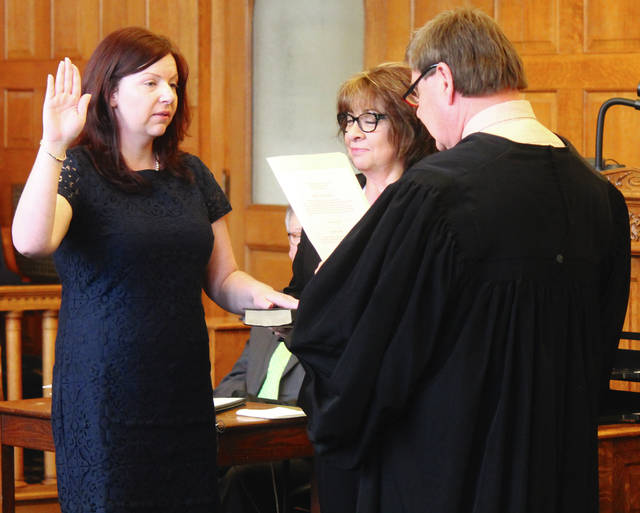 Anna Bolton | Greene County News Judge Michael Buckwalter gives Stephanie Hayden the oath of office March 30 in Greene County Common Pleas Court, swearing her in as the general division's newest magistrate. Hayden worked in the county prosecuting attorney's office for almost 12 years, first as a law clerk and then as an assistant prosecutor. Pictured by her side is her mother Cindy Boster-Hayden.