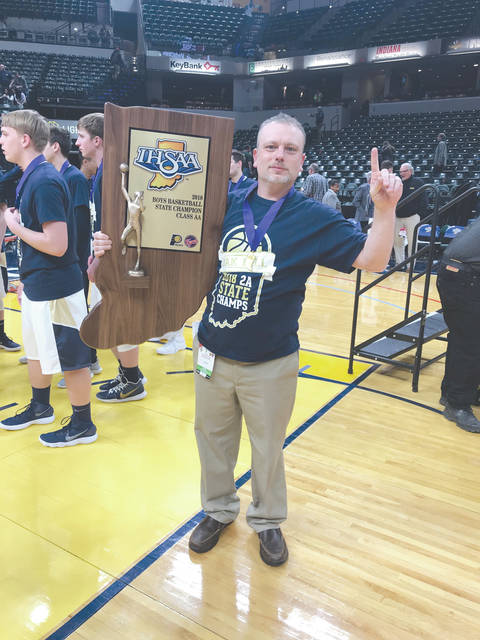 Xenia High grad Brad Shouse (Class of 1994) poses with the Indiana Boys 2A High School Basketball state trophy. Shouse is a member of the Oak Hill High basketball coaching staff. The team won the state 2A title on March 24 in Indianapolis.