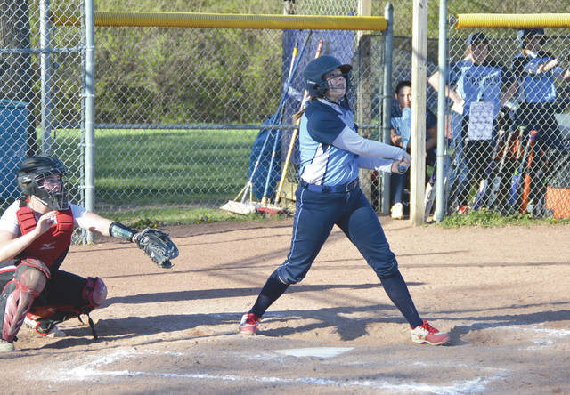 Fairborn sophomore Ashlyn Baker follows the flight of her two-run home run in the sixth inning April 20 at Fairborn Community Park's Joan Dautel Field.