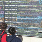 Students write on 'Before I Die' wall