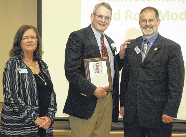 Scott Halasz | Greene County News Local businessman Brad Montgomery receives his plaque with Xenia Community Schools Foundation Executive Director Barbara Stafford (left) and President Steve Brodsky (right).