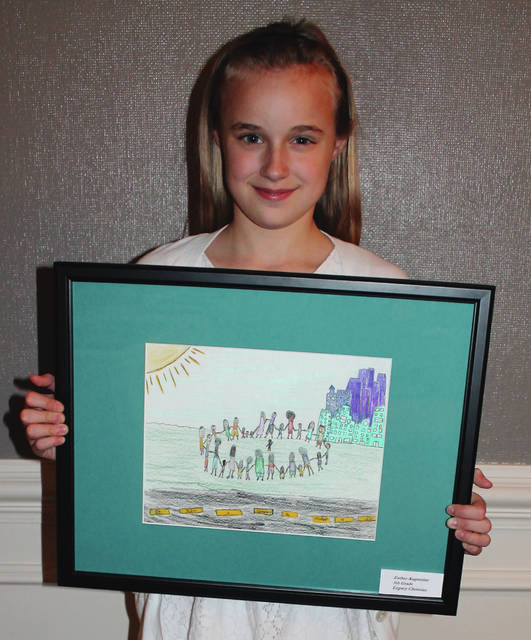 "Anna Bolton | Greene County News Esther Augustine, a 5th-grader at Legacy Christian Academy, won the grand prize for her artwork representing the theme ""It takes a community to protect a child."""