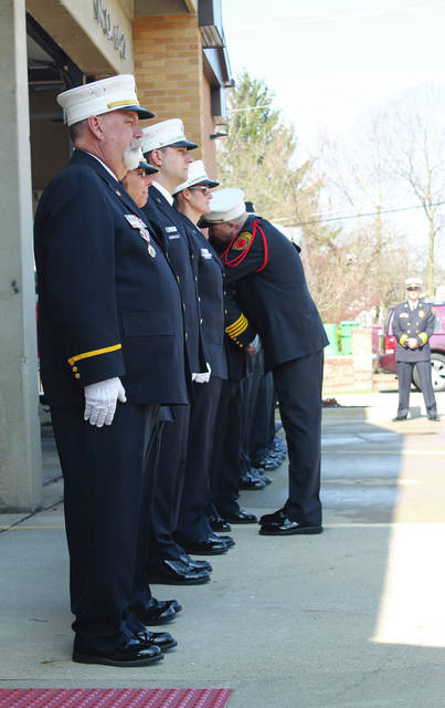Anna Bolton | Greene County News Beavercreek Fire Department held a flag ceremony April 26 at Station 62 for Lt. Brian Seabold, who is retiring after 37 years of service. Seabold makes his way down the line to say goodbye to each member of the department.