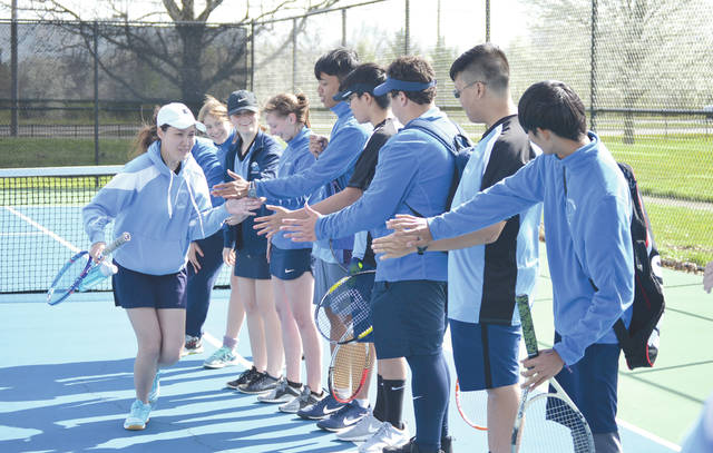 Fairborn's Mai Lin Kuttila high fives her Skyhawks tennis teammates prior to Wednesday's April 25, 3-2 win over Yellow Springs on the Fairborn Community Park tennis courts.