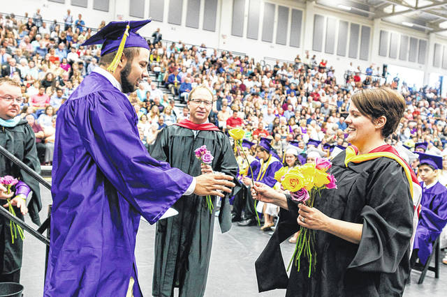Don Tate | Greene County News Bellbrook High School Class of 2018 seniors along with co-Valedictorians are Joey Derrico and Abby Schultz and salutatorian is Andrew Haberlandt graduated May 26 at Kettering's Trent Arena. Ninety percent of the class will attend college with more than $3 million in scholarship money earned.
