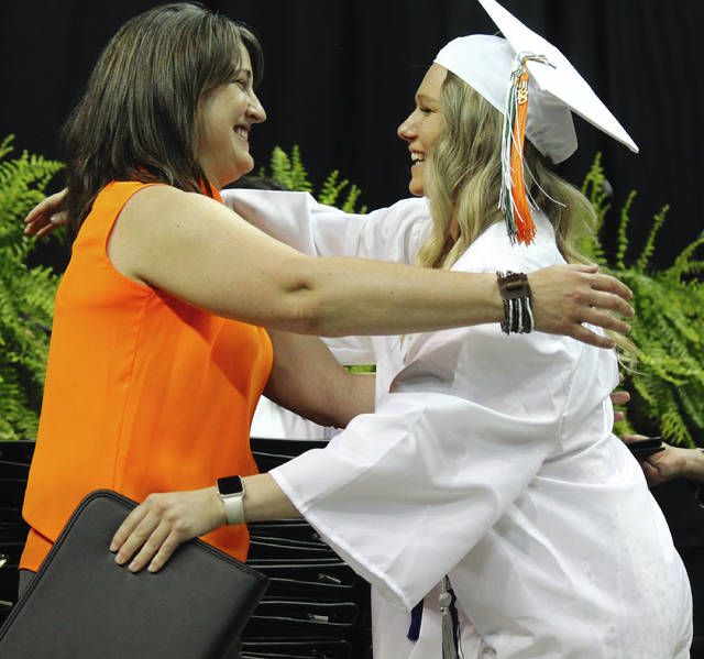 Veterinary science instructor Dr. Kelly Rickabaugh congratulates McKenzie Burke as she receives her certificate.