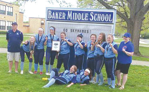 The Baker Middle School team poses in front of the school with their GWOC championship plaque. According to school records, they became the third Baker softball team to finish a season undefeated.