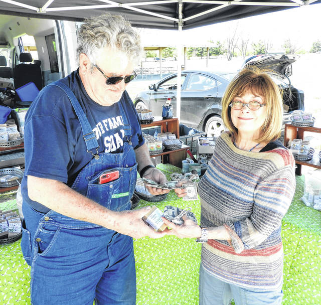 Submitted photos GCP&T Volunteer Grace Kline was the first customer at the first farmer's market hosted by the park agency. She went home with a handcrafted bar of soap from vendor Our Family Soap in Xenia.