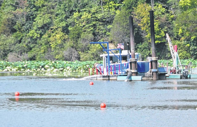 Orange buoys mark the submerged discharge pipe. ODNR warns boaters to use caution when operating in the area of dredging operations.