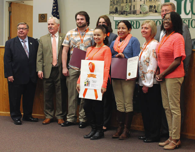 Anna Bolton | Greene County News Commissioners Bob Glaser and Alan Anderson, Family Visitation Center staff member Nick, Center Coordinator Libby Powers, staff members Megan, Julie, Ceci and Laurette and Commissioner Tom Koogler recognize supervised visitation awareness month at an April 19 meeting.