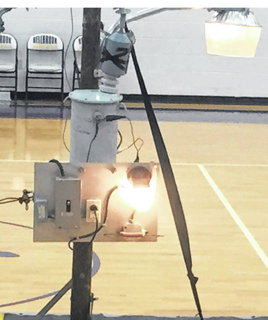 Submitted photos Representatives from Dayton Power and Light cook a hot dog using a basic wire found in a home. DP&L visited Bellbrook Middle School to show students about safety.