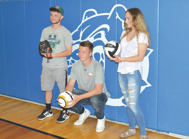 Left to right, Donnie Isenbarger will play baseball at Clark College in Vancouver, Wash., Fisher Lewis is headed to Ohio Northern University to play men's soccer, and Payden Kegley will attend Clark State in Springfield to play women's volleyball. The three student athletes participated in a mock signing ceremony May 14 at Yellow Springs High School.