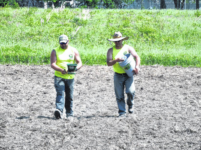 Submitted photos Allen Beam and Jason Carter, Greene County Parks & Trails Maintenance Team, sow tiny poppy seeds on prepared ground. Two acres of red poppies will bloom this summer at Hobson Freedom Park, 2910 Trebein Rd., Beavercreek, creating a backdrop for visitors' selfies, family photos and more. Hobson Freedom Park is home to tournament-quality athletic fields and has recently been improved with the addition of a playground, shelter, signature park fencing and a monthly farmer's market.