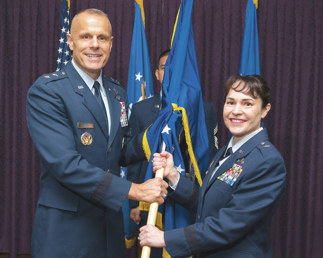 Submitted photo Brig. Gen. Alice W. Treviño accepts the Air Force Installation Contracting Agency flag from Maj. Gen. Bradley D. Spacy, Air Force Installation and Missing Support Center commander, as she becomes the AFICA commander during a change of command ceremony. Treviño assumed command from Brig. Gen. Cameron G. Holt who is slated to become the deputy assistant secretary of the Air Force for acquisition.