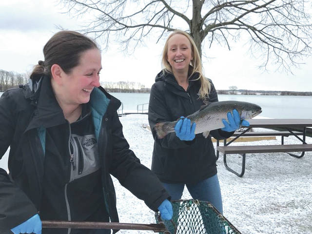 Submitted photo Danielle Trevino (holding fish) and Megan Shade with Base Natural Resources stock Bass Lake with trout.