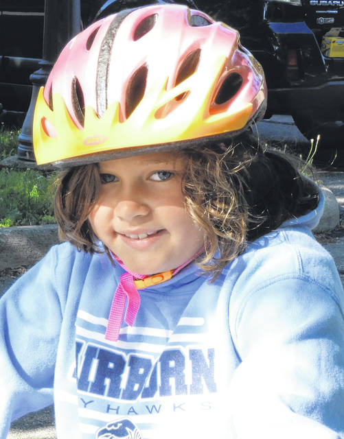 Cyclists are taught the rules and safety precautions needed on the paved trails network — including wearing a bike helmet.