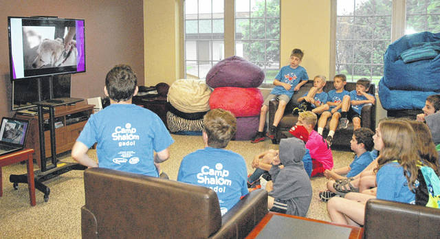 Scott Halasz | Greene County News Campers from the Jewish Federation of Greater Dayton's Camp Shalom watch a video about 4 Paws for Ability.