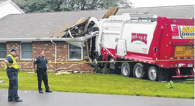 Photo courtesy WDTN A Rumpke garbage truck crashed into a Xenia nursing home June 21.