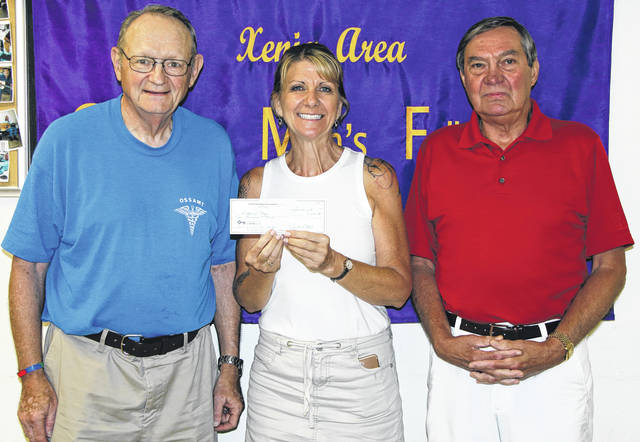 Submitted photo Proceeds and donations from the Mayor's Prayer Breakfast, held May 25, were recently presented to Bridges of Hope, Xenia's emergency homeless shelter. Pictured with the $2,000 check are John Sherer, event coordinator, Jill Conkel, BOH administrator, and Bob Altick, Xenia Area Christian Men's Fellowship treasurer.