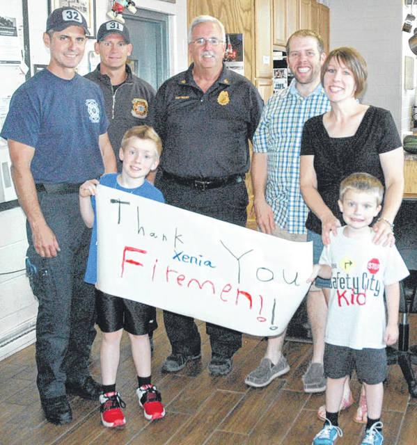 Scott Halasz | Greene County News Chelsey Garrett and her husband, Andy, visit Xenia firefighters every year on the anniversary of one of the well-known fires in Xenia. They are pictured with sons, Micah and Logan, and (left to right) Mike Bogan, Travis Dill, and Chief Ken Riggsby.