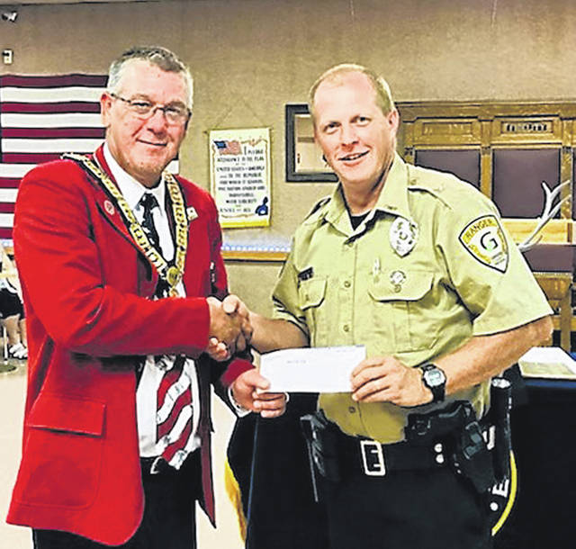 Submitted photo The Ohio Elks Association recently donated $676.78 to Greene County Parks & Trails (GCP&T) for the purchase of a ballistic vest for its ranger division. GCP&T Chief Ranger Brady Smith accepted the check on behalf of the park agency and as a member of Xenia Elks #668 from Elks Exalted Ruler Brent Avey at a recent meeting. GCP&T rangers serve as peace officers for the park agency and patrol its nearly 3,000 acres of parkland, 62 miles of paved trails, 36 miles of river trails and 12 miles of hiking trails.