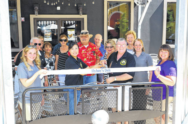 Barb Slone   Greene County News Flyboys at the Fairfield Commons Mall. They cut the ribbon Friday. Pictured are: Alexis Stiver, Mayor Bob Stone, Margaret Stone, John Sostrom, owners Eunice and Steve Crandall , Debborah Wallace, Susan Phillips, Dawn Mader and Beavercreek Chamber of Commerce President Amanda Byers.