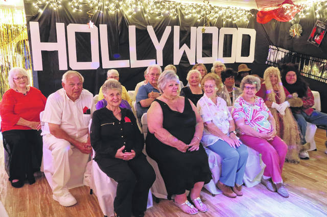 Submitted photos Jamestown Senior Center held their 4th Annual Senior Prom June 29. With a Hollywood gala theme, senior stars and starlets walked the red carpet as they arrived at the Jamestown Senior Center. Several of the 24 in attendance came dressed as Hollywood's elite actors and actresses. The evening included dancing, refreshments and games.