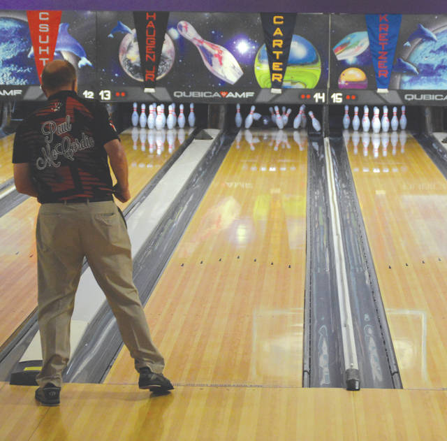Defending Fairborn Classic champion Paul McCordic of Sugar Land, Texas uses a little body English to help with a strike during Friday's July 13 Adult Pro Am event at Bowl 10 lanes in Fairborn.