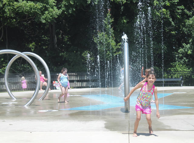 Anna Bolton | Greene County News Families gathered at Xenia Station July 13 to take advantage of the sunny afternoon. Kids splashed in the water and dried off in the sunshine at the playground.