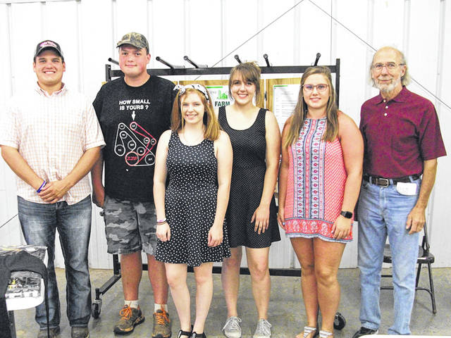 Greene County Farm Forum scholarship awards went to (from left): Bradley Eakle, Robert Bradley, Hailey Bowman, Emalyn Dant and Sarah Harner. They are pictured with scholarship chair Jim Byrd.