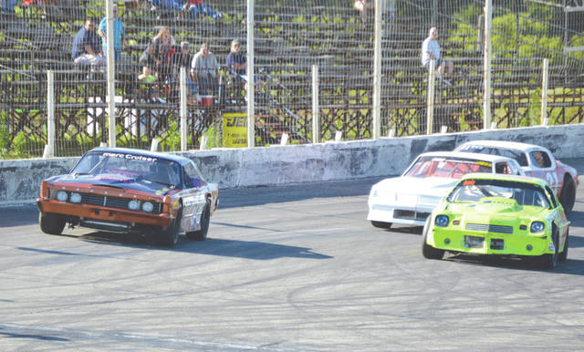 The Sunday Slam's closest finish came in a four-lap dash between the four fastest qualifiers in the Sports Stock racing division, July 8 at Kil-Kare Raceway. DeGraff's Buck Purtee (far left) edged Trotwood's Josh Longstreth (right) just before the finish line to claim the win.