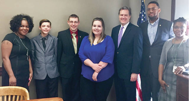 Submitted photo Young people from the foster care system explain the problem that inspired Congressman Mike Turner's bill. They are pictured here in his Dayton office in April 2017.