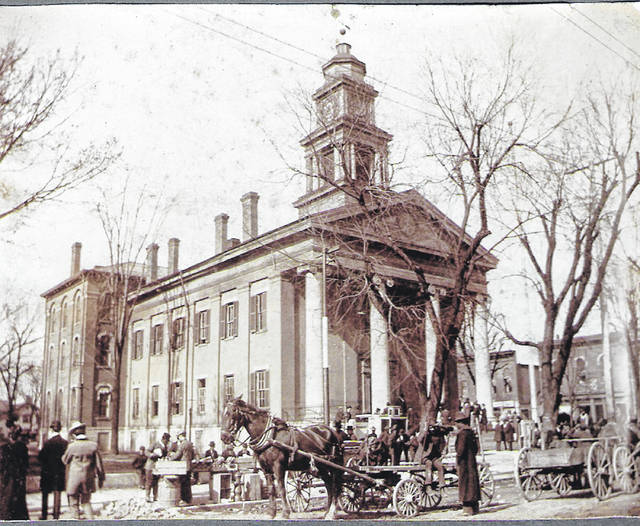 Courtesy of Greene County Historical Society Residents gather for a market day, probably a Saturday, in front of the old courthouse, before 1900. Farmers came into town to sell and buy on that day.