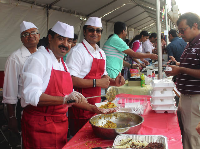 Anna Bolton | Greene County News Chefs serve up some authentic food at Grand Mela: A Festival of India Aug. 18 outside the Hindu Temple of Dayton in Beavercreek.
