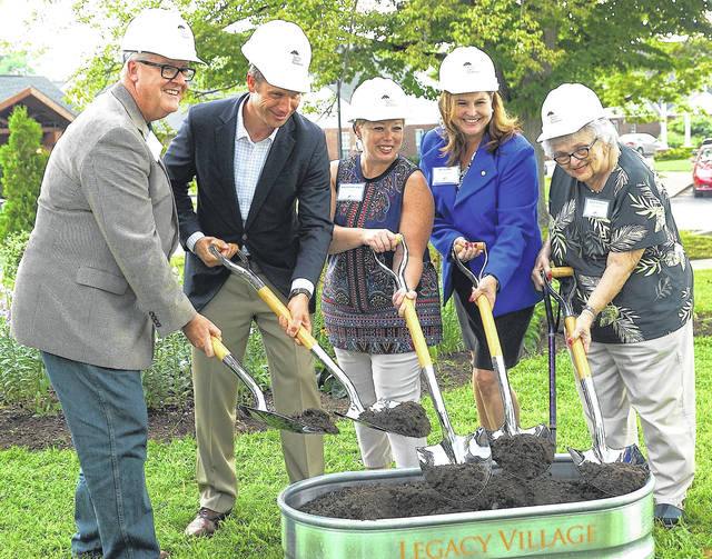Barb Slone | Greene County News Ruscilli Construction President Jim Cetovich, National Church Residences Senior Vice President Matt Rule, Xenia Mayor Sarah Mays, Huntington Bank Vice President Amy Becker, and Legacy Village resident Peggy Reynolds break ground on a new senior housing project at Legacy Village.