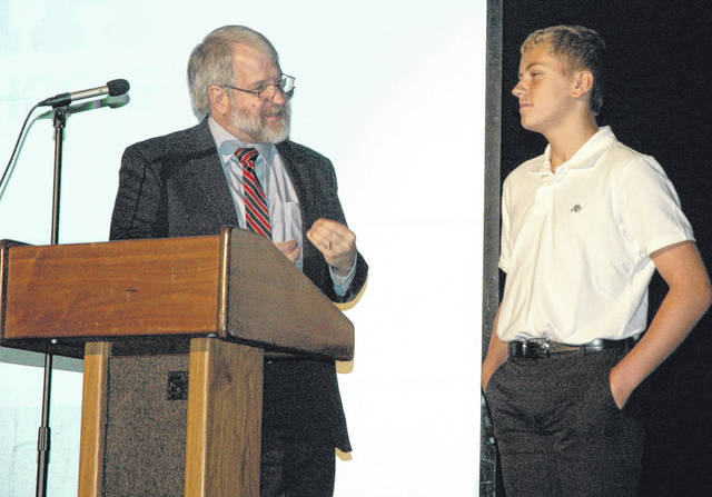 "Scott Halasz | Greene County News State Superintendent Dr. Paolo DeMaria speaks to Xenia freshman Will Miller during the district's opening day program for teachers and staff. DeMaria talked about the state's new strategic plan, ""Each Child, Our Future."""