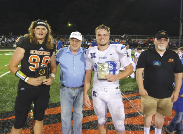 The Backyard Battle's Defensive Players of the Game — Beavercreek's Seth Owens (left) and Xenia's Nick Willis — stand with their awards alongside Beavercreek Mayor Bob Stone (center left) and Beavercreek Kiwanis President Gene Taylor, Aug. 24 at Frank Zink Field in Beavercreek.