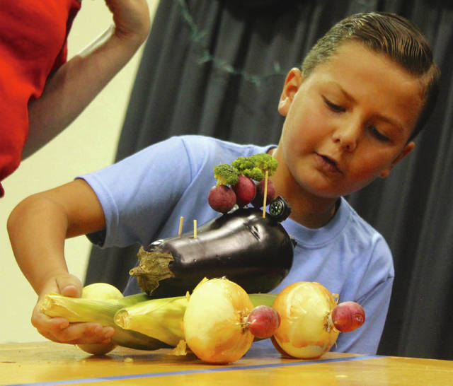 Anna Bolton | Greene County News Cloverbud youth race their veggie cars — made out of cucumbers, carrots, eggplants and more — at the Greene County Fair Assembly Hall Aug. 2.