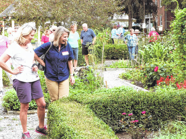 Master Gardener Susie Lentz leads a group through the display gardens at the park.