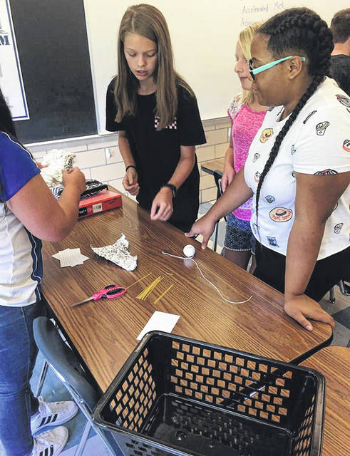 Submitted photos Rose Prater's seventh grade Math classes demonstrated problem solving by designing the tallest tower capable of supporting a golf ball, using only the limited materials provided. The activity followed discussion of the problem solving methods needed by members of Apollo 13 to successfully return to earth.