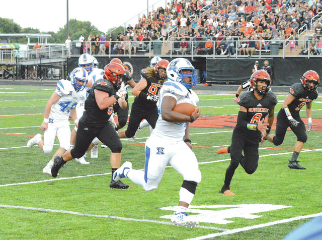 Xenia senior running back Sincere Wells rumbles for a 56-yard touchdown in the second quarter of Friday's Aug. 24 Backyard Battle high school football game in Beavercreek. Wells finished with 237 yards gained on the ground and four touchdowns in Xenia's 41-14 win.