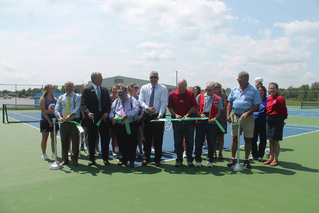Anna Bolton | Greene County News Greeneview High School women&#8217;s tennis team, County Commissioners Alan Anderson, Tom Koogler and Bob Glaser, Greeneview Superintendent Isaac Seevers, Lions Club members Dave Jordan and Bill Benedict, GHS Principal Neal Kasner, Jamestown Chamber of Commerce members Cory Newhouse and Norma Freeman, GCP&amp;T Director Jon Dobney, County Administrator Brandon Huddleson and other local supporters unveiled newly-renovated tennis courts at Frank Seaman Park Aug. 9 in Jamestown. <span style=&quot;font-size: 11pt;&quot;><span style=&quot;font-family: Garamond, serif; font-size: medium;&quot;><span style=&quot;font-size: 12pt;&quot;></span></span></span>