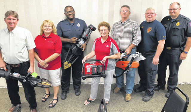Submitted photo Trustee Scott Miller, Fiscal Officer Sheila Seiter, Firefighter Bryan Simpson, Trustee Susan Spradlin, Trustee Steve Combs, Fire Chief Dean Fox, and Deputy Fire Chief Greg Beegle show off new equipment the department received.