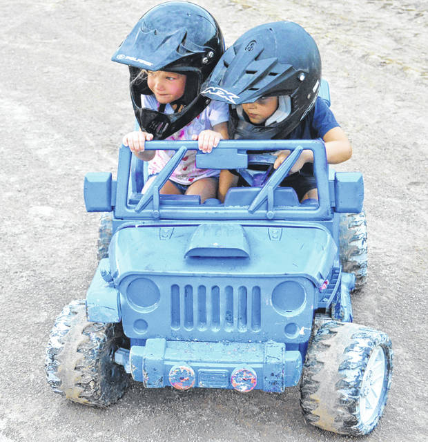John Bombatch   Greene County News The 2018 Greene County Fair is filled with a variety of entertainment for the family. Connor Ahrman and Lily Ahrman of Xenia participated in the kiddie demo derby July 30.