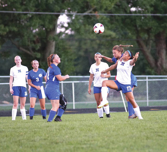 Xenia junior forward Alyssia Echols (17) and Greeneview freshman defender Ellie Snyder collide while going for the ball, Sept. 15, in a girls high school varsity soccer match at Don Nock Field in Jamestown.