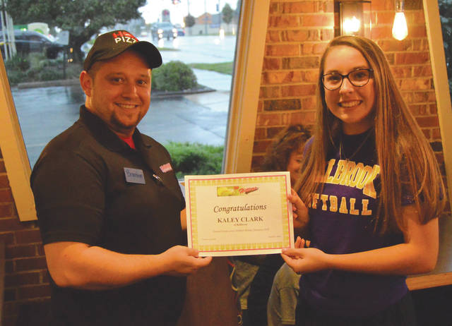 Pizza Hut general manager Brandon Beatty presents Bellbrook High School sophomore Kaley Clark with a certificate and $50 in Pizza Hut gift certificates in recognition of her 2018 Greene County high school softball batting title, Sept. 24 at the Xenia Pizza Hut location at 354 W. Main St.