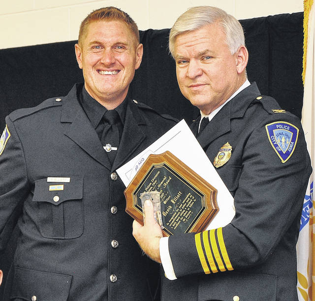 "Submitted photo Xenia Police Chief Randy Person presents officer David Elliott with the Casey Elliott Memorial ""City's Finest"" Award."