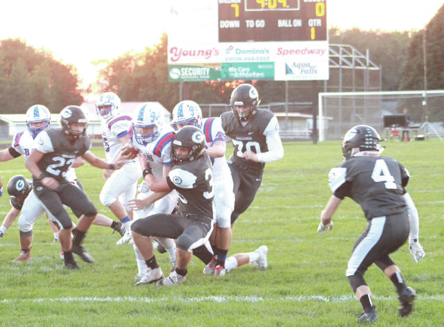 Greeneview quarterback Nick Clevenger (6) is taken down at the 5-yard line by Greenon's Logan Hurlbert (35).